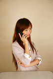 Asian girl using the phone Royalty Free Stock Images
