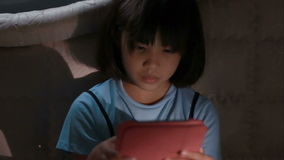 Asian girl using tablet computer in the dark, lonely stock footage