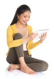 Asian girl using tablet computer Royalty Free Stock Photo