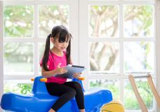 Asian girl using tablet , early education and learning