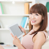 Asian girl using touch screen tablet Stock Photos
