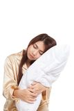 Asian girl  wake up  sleepy and drowsy with pillow Royalty Free Stock Photos