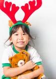 Asian girl wear antler Reindeer royalty free stock photo