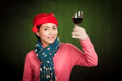 Asian girl wear christmas hat cheers with wine Stock Image