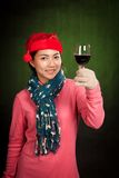 Asian girl wear christmas hat cheers with wine Stock Images