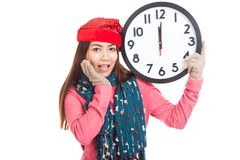 Asian girl wear  red christmas hat excited with clock at midnigh Royalty Free Stock Photos