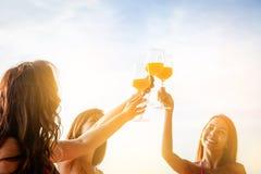 Asian girl wearing bikini holding a glass of orange juice stock photo
