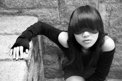 Asian girl wearing blindfold. Asian girl wearing a blindfold covering her eyes Royalty Free Stock Images