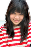 Asian girl wearing colorful stripes smiling Stock Images
