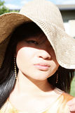 Asian girl wearing hat Stock Images