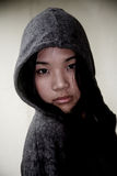Asian girl wearing a hood Stock Image