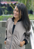 Asian girl wearing jacket. Asian teenager smile with happiness at the terace stock photo