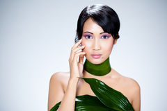 Asian girl wearing leaves Royalty Free Stock Photography