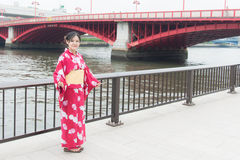 Asian girl wearing red kimono Stock Photos