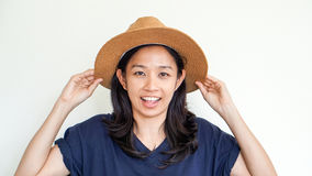Asian girl wearing straw hat summer fun. Relax and happy express Stock Images