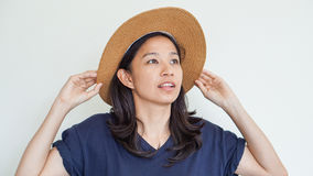 Asian girl wearing straw hat summer fun. Relax and happy express Royalty Free Stock Image