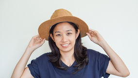 Asian girl wearing straw hat summer fun. Relax and happy express Stock Photography