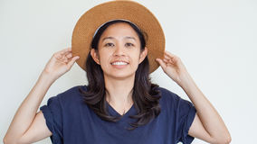 Asian girl wearing straw hat summer fun. Relax and happy express Stock Photos