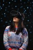 Asian Girl Wearing Virtual Reality Dark Glow Snow Background.  royalty free stock image