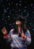 Asian Girl Wearing Virtual Reality Dark Glow Snow Background.  royalty free stock photo
