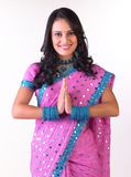 Asian girl in a wecome posture with pink sari Royalty Free Stock Image