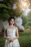 The Asian Girl in wedding dress in the forest Royalty Free Stock Photos