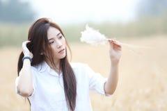 Asian girl at wheat field stock photos