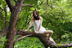 Asian girl in white over forest Stock Photography