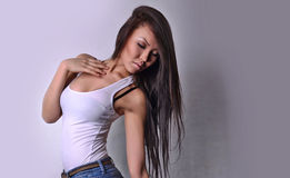Asian Girl, white shirt, blue jeans, bust, long hair Stock Photo