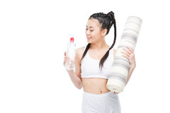 Asian girl in white sportswear holding yoga mat and bottle of water. Isolated on white Stock Image