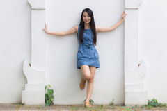 Asian girl and white wall Stock Photos