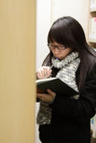 An Asian girl who is finding books in library Royalty Free Stock Photography