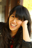 An asian girl who is smiling Stock Image