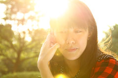 An Asian girl who is thinking. She thinks about her future and she is a businesswomen Royalty Free Stock Photos