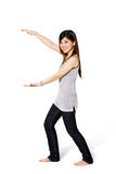 Asian girl wih hands wide apart. Young asian girl with a big smile with hand wide a part to the side Stock Photo
