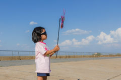 Asian girl with wind turbine in hands Stock Photos