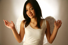 Asian girl with wings. Like an angel Royalty Free Stock Photography