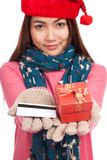 Asian girl with winter dress,credit card and gift box Royalty Free Stock Photography
