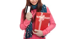 Asian girl with winter dress,credit card and gift box Stock Images