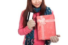 Asian girl with winter dress,credit card and gift box Royalty Free Stock Photos