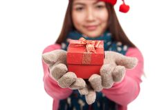 Asian girl with winter dress and gift box focus at box Royalty Free Stock Photos