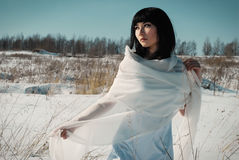 Asian girl in winter field Royalty Free Stock Photo