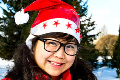 Asian girl in winter forest Royalty Free Stock Photography