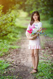 Asian Girl With Flower In The Garden Stock Photography