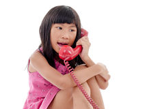 Asian Girl With Red Retro Phone Royalty Free Stock Photo