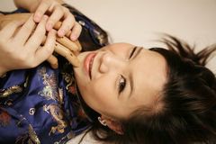 Asian girl with a wooden hand Stock Photography