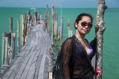 Asian girl on wooden pier koh samui Royalty Free Stock Images