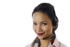 Asian girl working as customer service representative. Young people, work and technology, portrait of happy Asian girl working as call center operator with Stock Images
