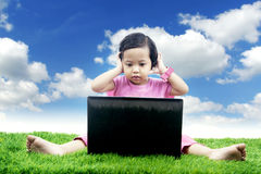 Asian girl worries looking at her laptop Royalty Free Stock Photo