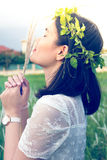 Asian girl with wreath of leaves Stock Photography